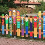 Fun Garden Fences Ideas with Interesting Panels using Colorful Patterns near Green Plantations
