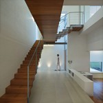 Brilliant Hallway Design of J20 House with White Colored Floor which is Made from Concrete Blocks and Light Brown Colored Wooden Staircase