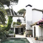 Marvelous Courtyard of French Country Inspired Homes with Wide Swimming Pool and Cozy Patio near French Doors