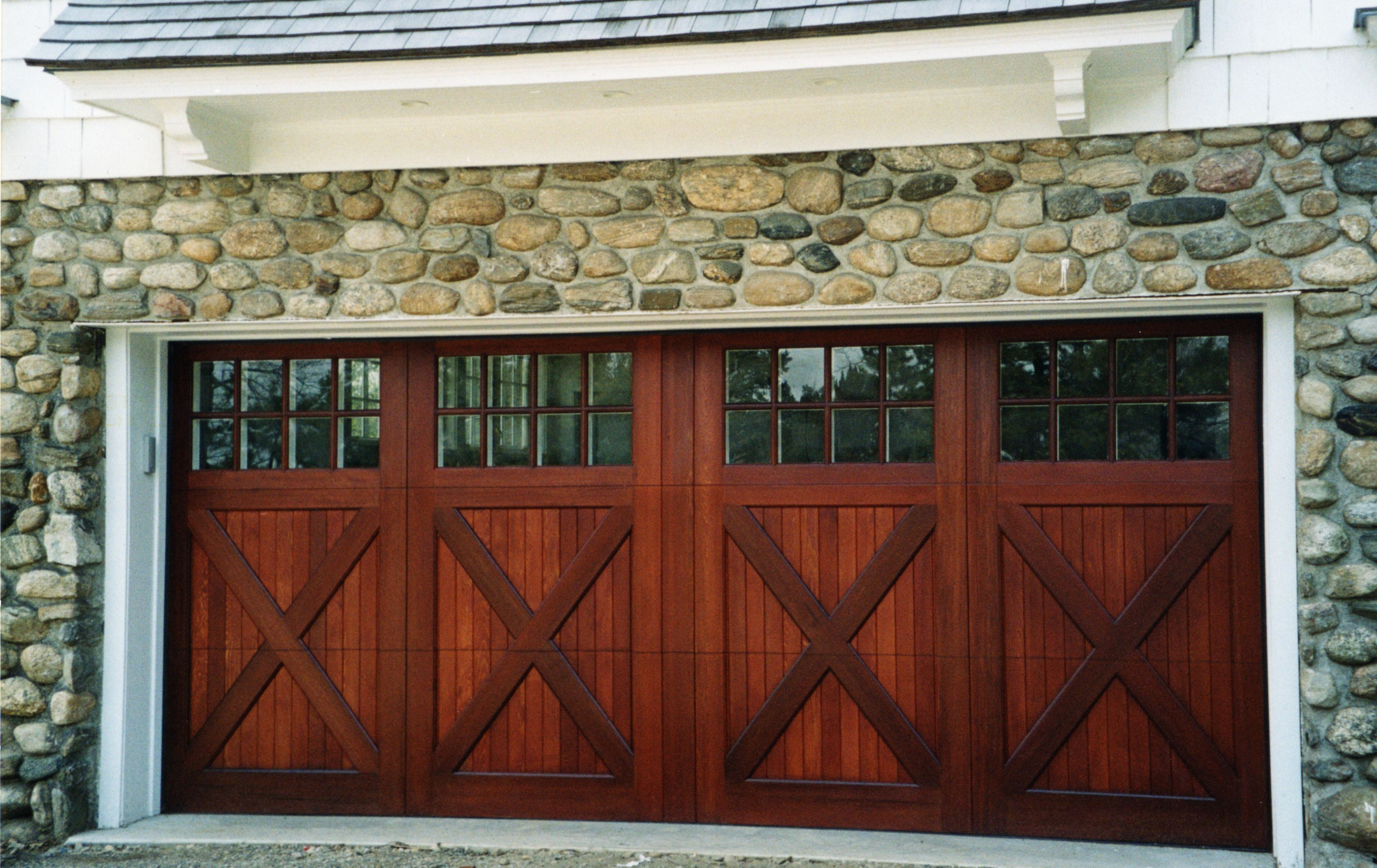 Installing carriage style garage doors to improve your for Carriage type garage doors
