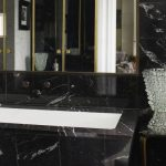 black-tiled-bathroom-with-white-chair